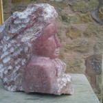 red head sculpture carved in indian soapstone
