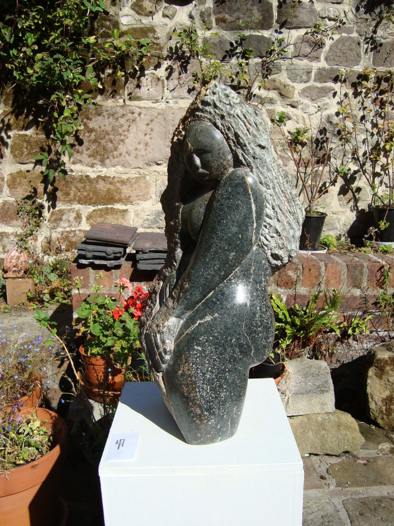 'Emerging' stone carving in polyphant soapstone