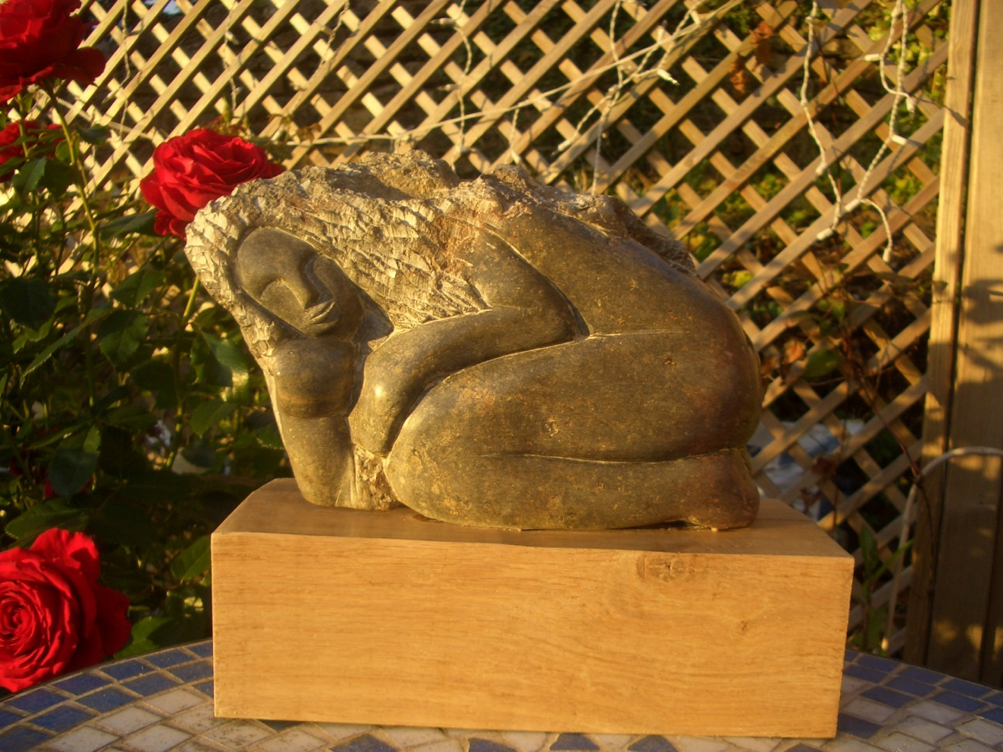'crouching woman' sculpture carved in opal stone